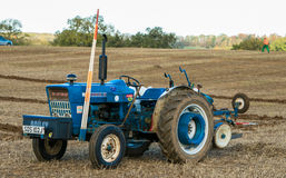 Old ford 3000 tractor. Old vintage blue ford 3000 tractor parked on stubble field. Competing in ploughing match Stock Photography