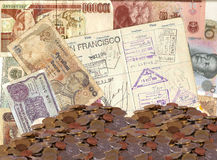 Old foreign currency and piles of coins. From around the world with passport Royalty Free Stock Image