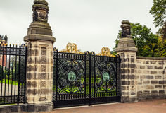 Old forged metal gate in stone colons. Entrance to palace Stock Images