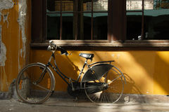 Old forgotten bicycle with flat tires Stock Image