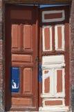 Old forgotten door in Fira village, Santorini island. Greece Royalty Free Stock Photos