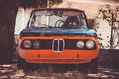 Old forgotten rustc car. Front view. Vintage filter Royalty Free Stock Photography