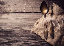 Old fork and spoon on wooden background Royalty Free Stock Photography