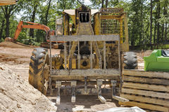Old forklift on construction site Stock Photo