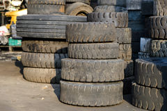 Old forklift tire. Column stack of old forklift tire Stock Photo