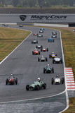 Old formula one cars in the strait line Stock Photos