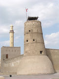 Old Fort (Dubai). This castle/fort is the oldest building still standing in Dubai (United Arab Emerites) which is now part of the Dubai museum. In the background stock photo