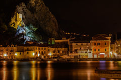 Old fort and facade of Omis at night, Croatia. Stock Photos