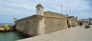 The old fort by the harbor at Lagos Algarve Portugal. Stock Photos