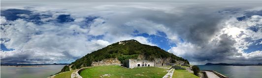 Old fort near seacoast, against cloudy sky. Shot in the sunny day. Panoramic photo. Santona, North Spain stock image