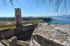 An old fort with an observation tower on which hangs a huge ancient clock.  royalty free stock images