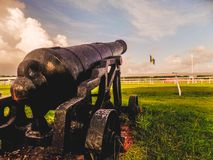 Old Fort Savannah Cannon. Vintage cannon depicting the Heritage of Barbados pointed at the newly erected monument royalty free stock photography