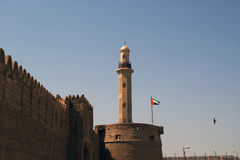 Old Fort and  tower of a nearby mosque. Dubai Stock Photo