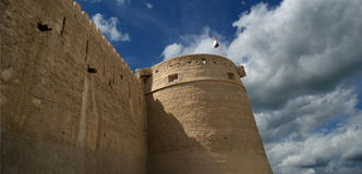 Old Fort and  tower of a nearby mosque. Dubai Stock Photography