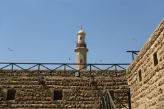 Old Fort and  tower of a nearby mosque. Dubai Royalty Free Stock Images