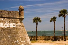 Old fort wall and turret. A view of one point of the stone wall and a gun turret at the old 15th century Spanish fort at St. Augustine, Florida as it defends the Stock Photos