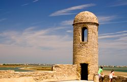 Old fort wall and turret. A view of one point of the stone wall and a gun turret at the old 15th century Spanish fort at St. Augustine, Florida as it defends the Stock Image