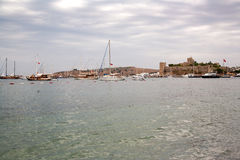 The old fortified castle. Coast and harbor with boats,View of the port Bodrum Kale, castle. Royalty Free Stock Photos