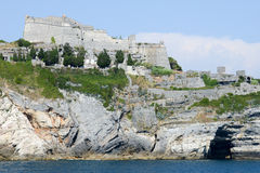 Old fortless on a rocky coastal outcrop at Portovenere Stock Photography