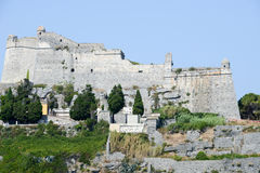 Old fortless on a rocky coastal outcrop at Portovenere Royalty Free Stock Images