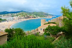 Old fortress on background of resort town of Tossa de Mar, sea and mountains, Costa Brava, Spain. Old fortress on background of popular resort town of Tossa de royalty free stock photos