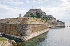 Old Fortress with the church of St. George on Corfu in Greece. Part of the defences of Corfu City - the Old Fortress with the hill of Castel a Terra and the Royalty Free Stock Photo
