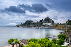 The Old Fortress in Corfu. Looking across Mandraki Harbour to the old fortress in Corfu stock photo