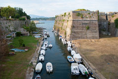 Old fortress of CorfuOld fortress of Corfu. Canal with boats to the old fortress of Corfu Stock Photos