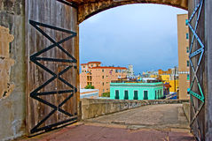 Old fortress doors on cloudy day Stock Photography