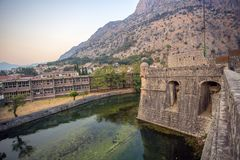 An old fortress in Europe along which a river flows. Montenegro 2017year. the city of Kotor. Wall of a stone fortress Stock Images