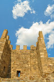 Old fortress in Feodosiya. Tower of an old fortress over which clouds float Royalty Free Stock Photography