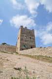 Old fortress in Feodosiya. Tower of an old fortress over which clouds float Stock Photography