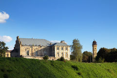 Old Fortress, Fire Tower, grass and blue sky. Grodno, Belarus Stock Photo