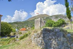 Old fortress with flag. Old fortress with flag in the Old Bar town Royalty Free Stock Images