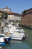 The old fortress Fortezza Nuova with channel,boats and houses in Livorno,Italy Royalty Free Stock Image