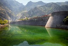 Old fortress of Kotor. Tower and wall, mountain at the backgroun royalty free stock photography