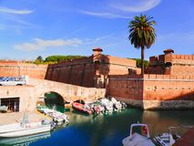 Old fortress in leghorn, Italy. Old fortress in the city of Leghorn Livorno ,Italy, castle, fortification, on the sea, canals, boats Royalty Free Stock Photo