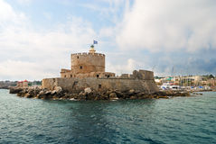 Old fortress with lighthouse. In Rhodes (Greece royalty free stock image