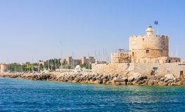 Old fortress with lighthouse.Mandraki. Rhodes Island. Greece Stock Image