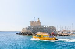 Old fortress with lighthouse in the port of Mandraki. Rhodes Royalty Free Stock Photo