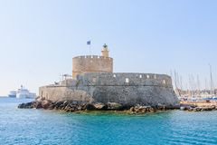 Old fortress with lighthouse in the port of Mandraki. Rhodes Royalty Free Stock Image