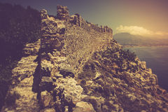 The old fortress and Mediterranean sea in Alanya, Turkey. Filtered image:cross processed vintage effect Royalty Free Stock Photography