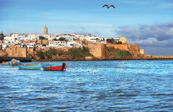 Old fortress in Morocco with boats on the waters of the Gulf royalty free stock photos