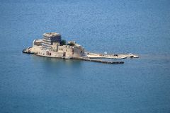 Old fortress and old prison, Bourtzi, in Argolis bay, Nafplio, Greece. Old Venetian fortress and old prison, Bourtzi, in Argolis bay, Nafplio, Greece royalty free stock image