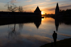 Old fortress. On the river at sunset. Russia, Pskov Kremlin Stock Images