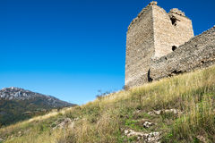Old fortress ruins. Wall and tower of an old military fortress Royalty Free Stock Image