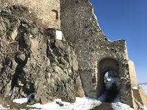 Old fortress Rupea in winter - Romania. Arched entrance in old, historical fortress of Rupea, German Reps; Hungarian: KÅ'halom, `mound of rocks`; Latin Ripa stock photos
