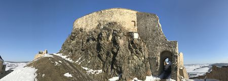 Old fortress Rupea in winter - Romania. Arched entrance in old, historical fortress of Rupea, German Reps; Hungarian: KÅ'halom, `mound of rocks`; Latin Ripa stock photography