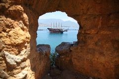 The old fortress. Sea. Ship. View of Alanya harbor from Alanya peninsula. royalty free stock images