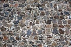 Old fortress stone masonry wall pattern Stock Images